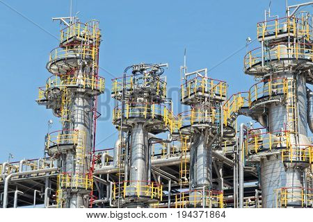 view of petrochemical columns in the shop for oil refining
