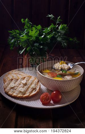 Soup khash in the plate bread and a bunch of parsley. Natural food.