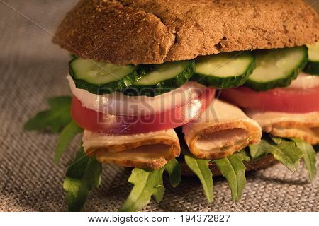 Breakfast sandwich closeup homemade. bread, bacon, tomatoes, cucumbers.