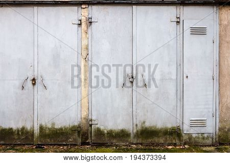 Two old gray steel doors on a wall. Architecture detail background
