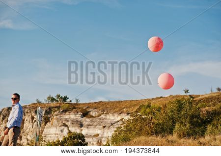 Lonely Groom Admiring Breathtaking View Of Lake With Balloons Flying On The Background On His Weddin