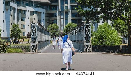 Nuns Walk In The Gardens Of The Sanctuary Of Lourdes