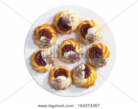 Shortbread cookie with jam and sugar icing in plate isolated on white background top view