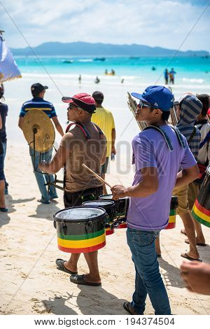 BORACAY, WESTERN VISAYAS, PHILIPPINES - JANUARY 11, 2015: Drummers playing music at the Ati-Atihan Festival at White Beach.