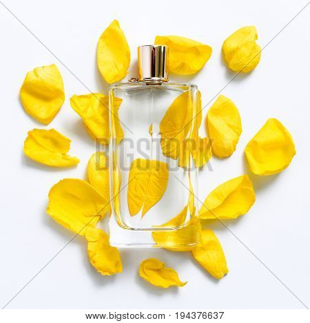 Perfume bottle with flower petals on light background. Perfumery, fragrance collection. Women accessories