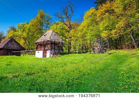 Typical Transylvanian old peasant house and wooden watermill Astra village museum Sibiu Transylvania Romania Europe