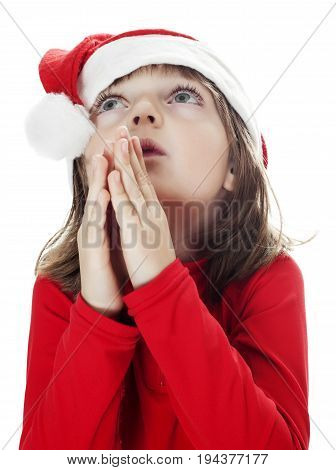 a little girl with a santa cap plead about a christmas gifts