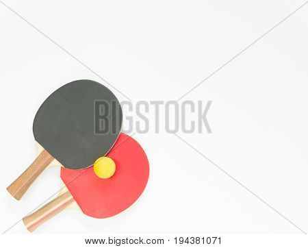 Sport background. Red and black ping-pong rackets and balls. Flat lay top view
