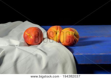 Peaches on a blue rustic table