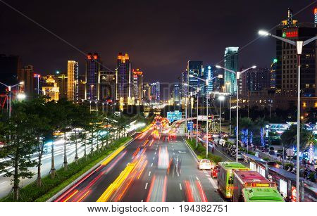 Nanning, China - June 9, 2017: Qingxiu District Busy Traffic With Light Trails And High Illuminated