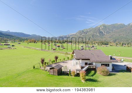 View of Alpine highland pasture in valley at foothills of Bavarian Alps