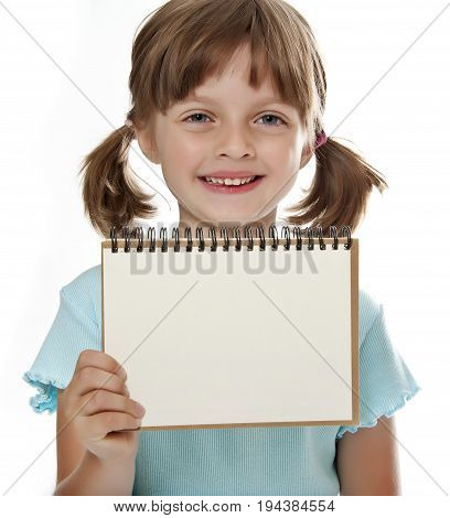 little girl holding empty white notebook isolated on white