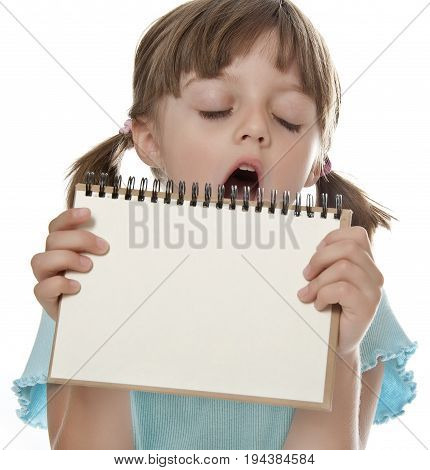 boring little girl holding empty white notebook