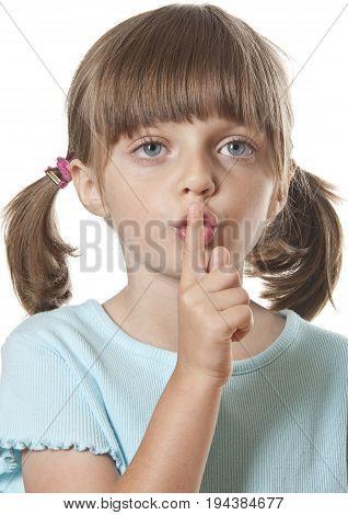 silence or secret concept (portrait of little girl)