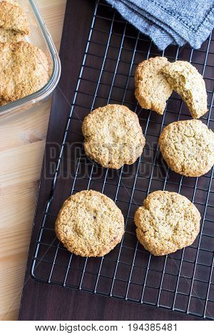 Gluten Free Homemade Oatmeal Cookies And Napkin On Cooling Rack. Vertical