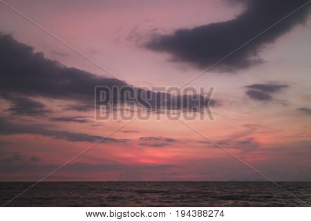 Incredible Purple and Pink Sunset Afterglow on Cloudy Sky over the Placid Sea in Thailand