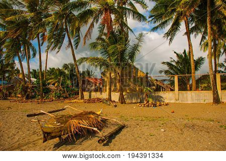 A Small Outrigger Style Banca Boat Rests On A Tropical Beach.pandan, Panay, Philippines.