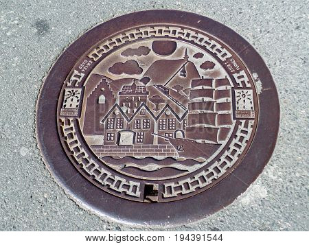 Manhole Cover at Bryggen, the Historic Harbor District in Bergen, Norway