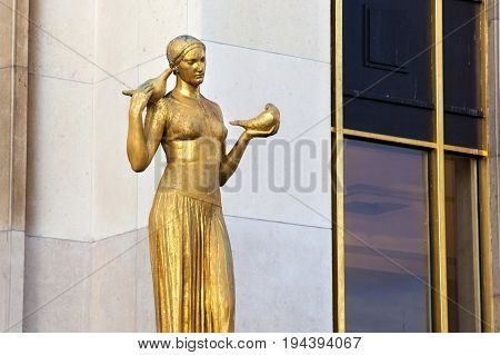 Gilded statue of a woman on the Place du Trocadero in Paris France.