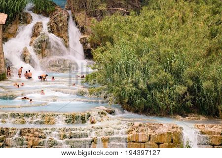 Saturnia Italy - June 25 2017: Natural spa with waterfalls in Saturnia Tuscany Italy.