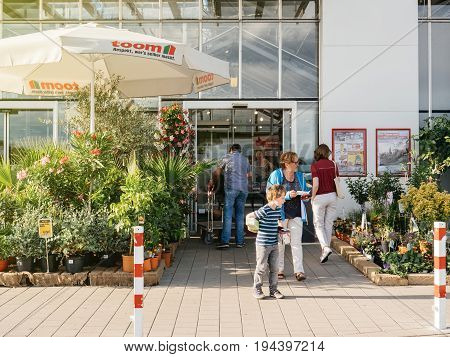 FRANKFURT GERMANY - JUN 30 2017: TOOM Baumarkt entrance - the German DIY-store chain offering home improvement and do-it-yourself goods - customers buying goods selecting the best tools