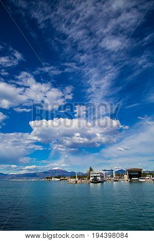 View of the port in Peschiera Del Garda on Lake Garda Lombardy Italy.