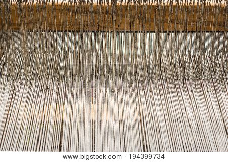 Part of loom white thread homemade clode-up abstract background