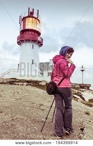 Tourist At Lindesnes Lighthouse In Norway