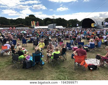 SOUTHAMPTON UK - July 8 2017: Lets Rock Southampton 80s music festival in Southampton UK. People sitting and listening to music at the concert.