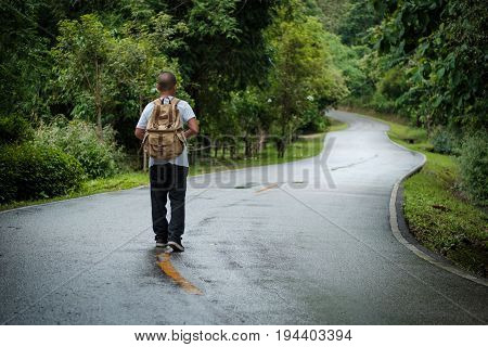 young asian boy traveling alone at park, vintage tone