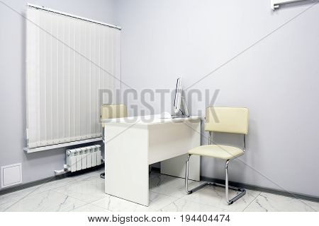 Office space for the manager's work: a computer desk and chair a computer