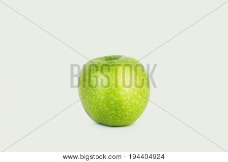 Fresh big green apple on white isolated background in the middle