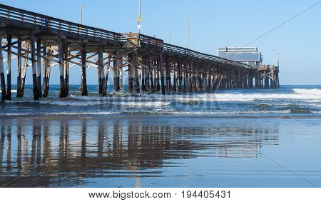 Side view of Newport Beach pier structure