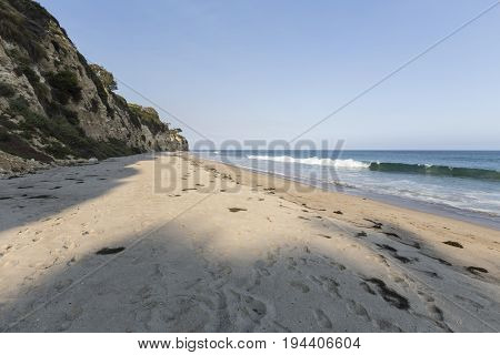 Late afternoon at secluded Dume Cove Beach in Malibu, California.