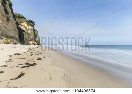 Secluded Dume Cove beach with motion blur water near Los Angeles in Malibu, California.
