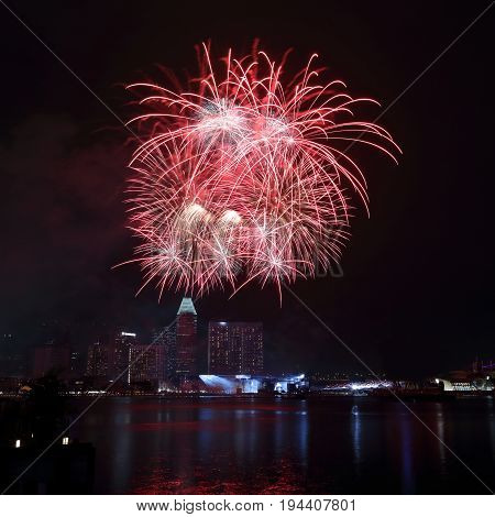 Fireworks for the celebration of Singapore's national day over downtown Singapore skyline