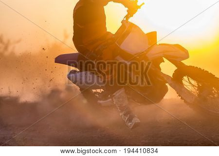 Silhouette motocross incress speed in track .
