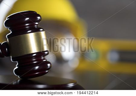 Construction law theme. Gavel and constructor helmet.