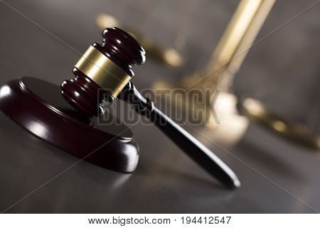 Lawyer office. Gavel, golden scale of justice. Gray stone background. Place for text.
