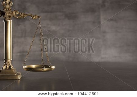 Scale of justice. Law concept. Gray background.