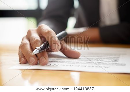 Hand Of Businessman In Suit Filling And Signing Contract,have A Contract In Place To Protect It,sign