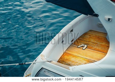 Stern Cruise Motor Yacht And Blue Sea, Closeup Sea Water Transport Concept