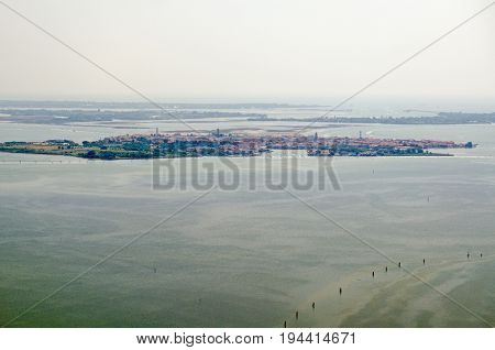 Aerial view of the Venetian Lagoon with the island of Murano to the fore and behind it the less populated Le Vignole and Saint'Erasmo with the Adriatic Sea beyond.