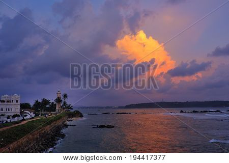 Galle lighthouse stands guard over the Indian ocean at sunset; SriLanka coast in 2016.