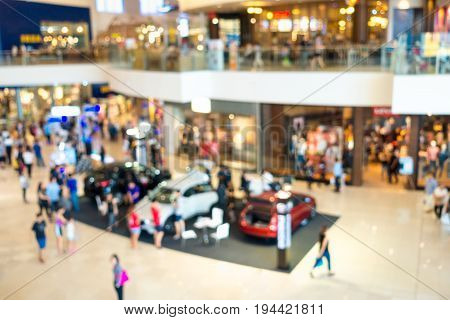 Abstract blurred motor show in department store