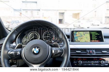 Sankt-Petersburg Russia March 05 2017 BMW X5M 2017 close up of steering wheel with navigation screen multimedia system car interior details on test-drive in Sankt-Petersburg at March 05 2017