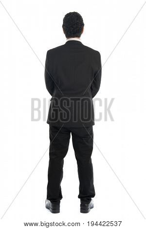 Full body back view of young Southeast Asian businessman standing isolated on white background.