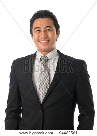Portrait of good looking young Southeast Asian businessman standing isolated on white background.