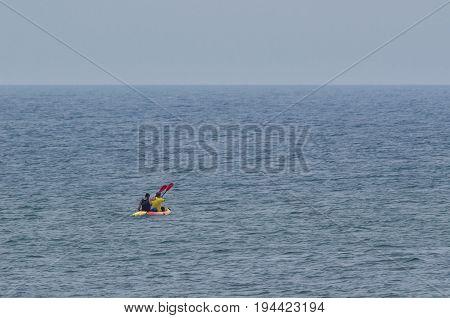CANOEISTS - Canoeists practice swimming at sea