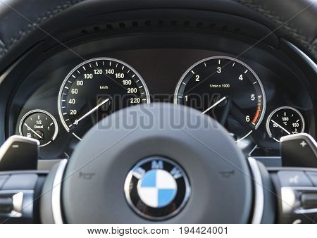 Sankt-Petersburg Russia March 05 2017 BMW X5 2017 close up of car instrument panel dashboard with speedometer tahometer car interior details on test-drive in Sankt-Petersburg at March 05 2017